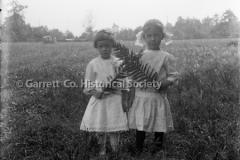 1449-Two-Girls-Holdi44BA54