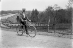 1924-Man-on-Bicycle-784A