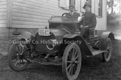 2421-Two-Men-in-Car-44C0F1