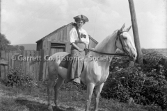 2424-Woman-on-Horse-44C0F4