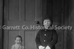 0548-Child-with-Doll44B48C