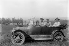 0555-Three-Men-in-Auto-555