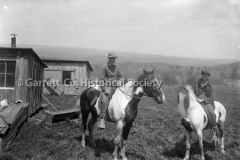 0562-Two-Men-on-Horses-562